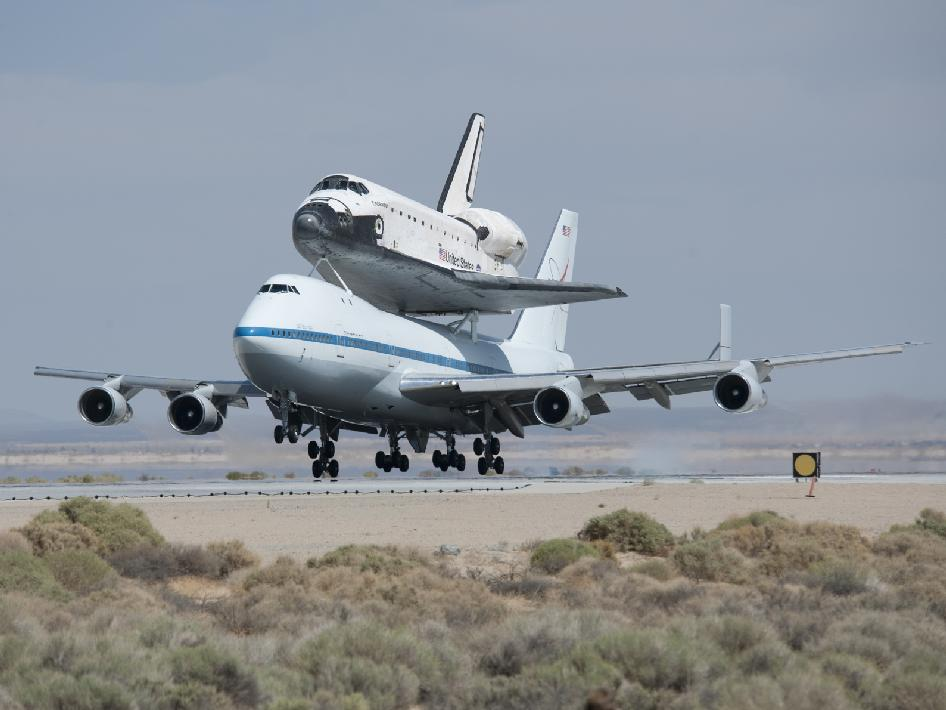 NASA's Shuttle Carrier Aircraft with the space shuttle Endeavour securely mounted on top touches down at Edwards Air Force Base after third leg of its four-segment final ferry flight from the Kennedy Space Center in Florida to Los Angeles International Airport on Sept. 20, 2012.
