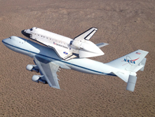 NASA's Shuttle Carrier Aircraft carrying space shuttle Endeavour soars over the high desert of Southern California following takeoff from Edwards Air Force Base Friday morning on the last