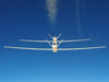 NASA's two Global Hawks – one configured as a tanker and the other as a receiver – fly in trail formation during the DARPA-Northrop Grumman autonomous UAV-to-UAV aerial refueling research project.