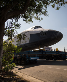Space shuttle Endeavour is maneuvered up Crenshaw Boulevard on its way to its new home at the California Science Center in Los Angeles on Saturday, Oct. 13, 2012.