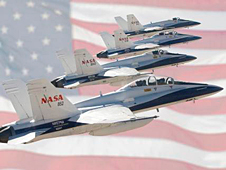 collage of four F-18s super-imposed over American flag.