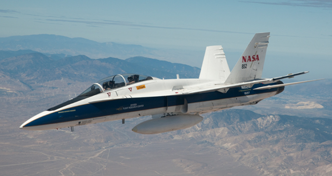 NASA's F/A-18B mission support aircraft 852 is pictured flying over the high desert near the Tehachapi Mountains northwest of Mojave, Calif.