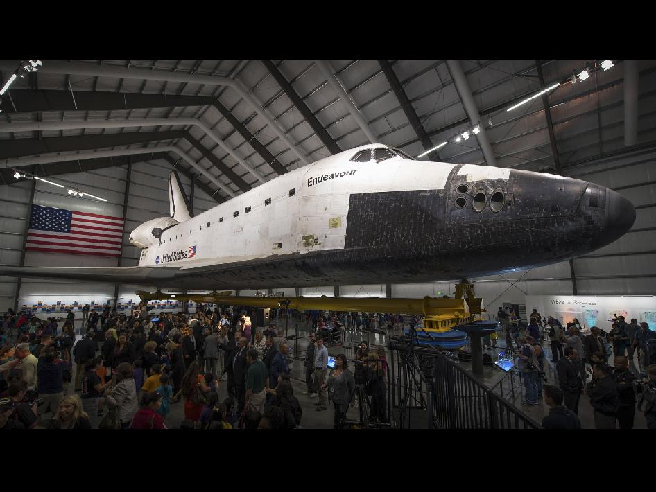 Throngs of visitors milled around the space shuttle Endeavour following grand opening ceremonies for the Endeavor exhibit Oct. 30 in the Samuel Oschin Pavilion at the California Science Center in Los Angeles.