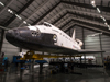 Space shuttle Endeavour, mounted atop its strongback transporter frame on seismic pedestal supports, is shown in the Samuel Oschin Pavilion at the California Science Center in Los Angeles prior to the exhibit's grand opening ceremonies Oct. 30.