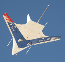 Boeing's X-48C Blended Wing Body research aircraft is silhouetted against the morning sky over Edwards Air Force Base during its fifth test flight on Oct. 16. It has flown eight times since Aug. 7.