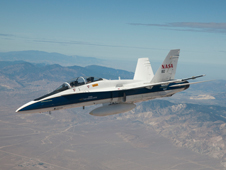 Dryden's F/A-18B mission support aircraft No. 852 flies near the Tehachapi Mountains.
