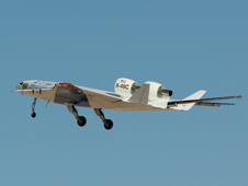 The X-48C Hybrid / Blended Wing Body technology demonstrator lifts into the skies after taking off from the bed of Rogers Dry Lake at Edwards Air Force Base on its first test flight on Aug. 7, 2012.