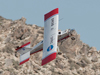 NASA Dryden's DROID small unmanned research aircraft executes a hard right climbing turn to avoid crashing into a rocky desert ridge during flight tests of a miniature ground collision avoidance system for small unmanned air vehicles.