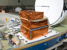 NASA Goddard's Cloud Physics Lidar electronics are installed in the upper area of NASA's Global Hawk unmanned aircraft in preparation for the ATTREX mission.