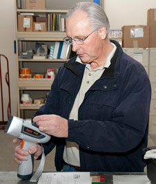 Scott Erickson prepares a material analyzer to determine the quality of metal sheets that were delivered to Dryden.