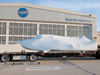 The flatbed truck and trailer that transported Sierra Nevada Space Systems' Dream Chaser engineering test article pauses behind Hangar 4802 on the aircraft ramp at NASA's Dryden Flight Research Center on Edwards Air Force Base, Calif., upon arrival at the center May 15.