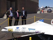 Dryden Director David McBride, right, shows the X-48C to Jaiwon Shin, and Robert Pearce.