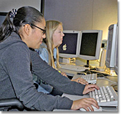 Lucia Miranda (left) and Annie Hunter trouble-shoot computers at Dryden.