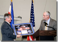 NASA Administrator Sean O'Keefe (right) presents a plaque to Fernando Gutierrez, Costa Rica's Minister of Science and Technology in San Jose, Costa Rica on March 3, kicking off NASA's AirSAR 2004 campaign.
