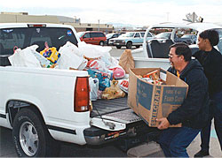 photo: Dryden employees unloading treats and gifts donated by the Center employees for needy people