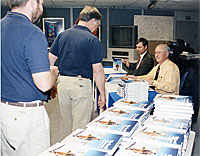 photo:Research pilot don Mallick signs his new book.