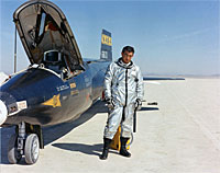 Michael Adams poses beside the number one X-15.