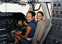 Leah Robson, left, and Bridgette Puljiz get a look at the NASA 747 from the co-pilot's seat.
