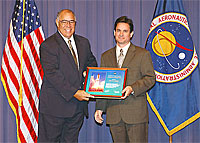 photo: Brent R. Cobleigh received a certificate from NASA Deputy Administrator Frederick D. Gregory.