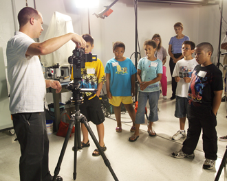 Children watch demonstration in Imaging Technology Center