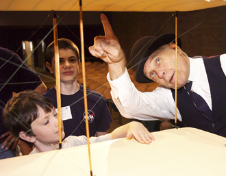 Children learn about the Wright Brothers' plane