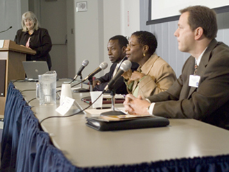 Heyward moderates the distinguished panelists that included, left to right, Dr. Whitlow, Dr. Plummer and Peterson.