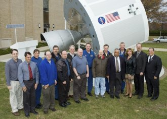 Group award winners with STS-115 crew.