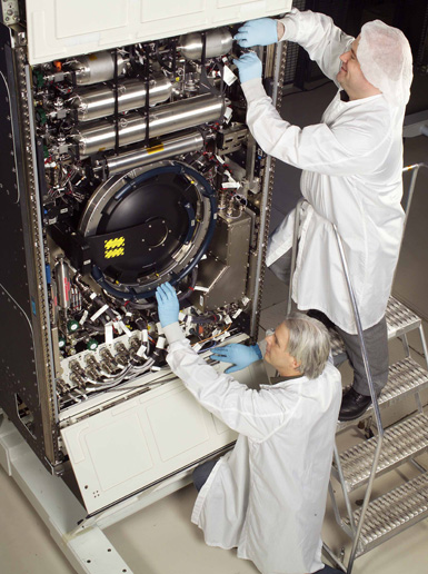 Image of Politi and O'Toole working on the Combustion Integrated Rack.