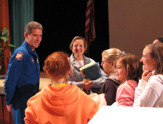 Astronaut Michael Good and students