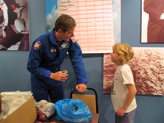 Astronaut Michael Good talks to Young Astronaut Day participant
