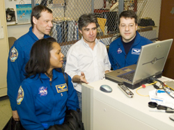 Image of Pereira and crew members in Glenn's Ballistics Impact Lab.