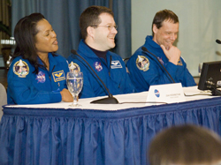 Image of Higginbotham, Patrick and Fuglesang during panel talk.