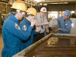 Image of Everett, Kerka and crew members in the  Fabrication Shop.