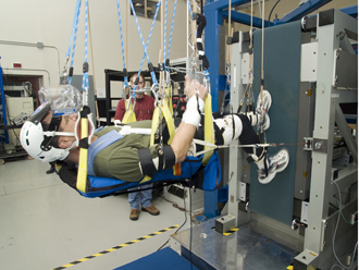 Astronaut tests Glenn biomedical hardware. C-2007-451. Credit: Marvin Smith (RSIS)