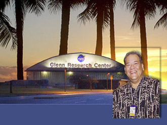 Image of Deputy Director in Hawaiian shirt in front of Glenn Hangar.