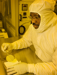 Image of Dr. Okojie in cleanroom. C-2007-2513. Credit: NASA/Marvin Smith (RSIS).