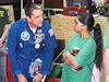Astronaut Don Thomas chats with students and signs autographs