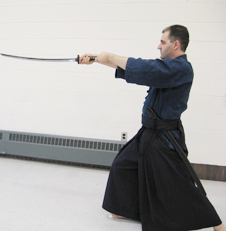 Photo of employee performing martial arts with sword. Credit: Courtesy of Cvetan Pavloski.