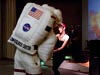 Woman dances with astronaut mascot