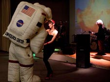 Woman dancing with astronaut mascot