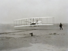 The Wright Flyer at Kitty Hawk.