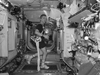 Astronaut Bob Thirsk exercises on treadmill with Glenn Harness