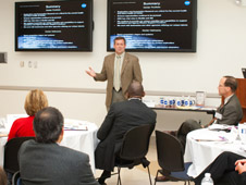 Michael Foreman speaks during a Leadership Exchange Partnership meeting