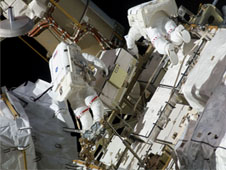 Astronauts work to replace a battery unit during the space shuttles Endeavour's STS–127 mission