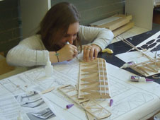 A student builds a plane.