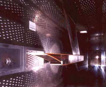 Photo of a hydrogen-fueled exhaust nozzle being tested in the 8- by 6-Foot Supersonic Wind Tunnel in support of an environmentally friendly, supersonic commercial transport.