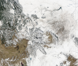 On Oct. 6, 2003, NASA's Terra satellite MODIS instrument captured this blanket of snow over Montana, top right, and Wyoming, bottom right, and the mountains of Idaho, left.