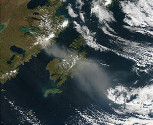 This image captured by MODIS on the Terra satellite on September 21, 2003, shows a cloud of volcanic ash over Kodiak Island, Alaska.