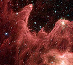 Spitzer Captures Cosmic Mountains Of Creation