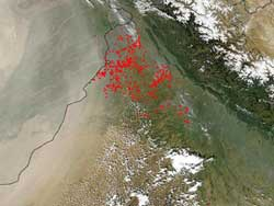 Dust and smoke from fires over northwestern India and Pakistan may contribute to a change in rainfall patterns over the region.
